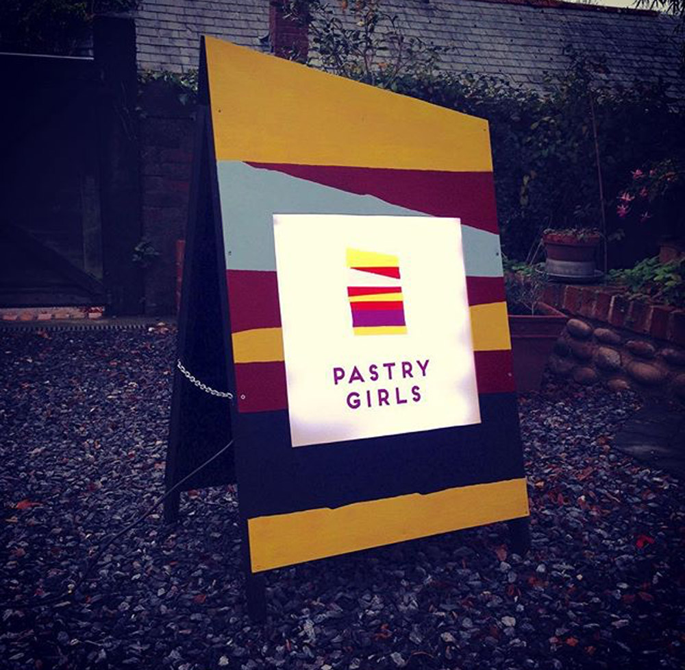 fabrication-signage-pastry-girls - custom wood framed light box & out door sign
